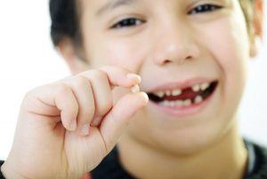 зуб мальчика